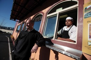 Aprisas Kirk Lance (left) and Pedro Garcia offer a take-out Mexican restaurant in a converted cargo container parked near Southeast Eighth Avenue and Division Street.